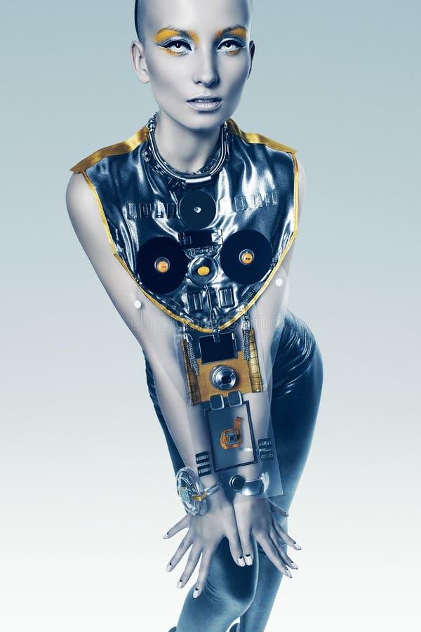 服装的性感的靠机械装置维持生命的人妇女 皇族释放例证