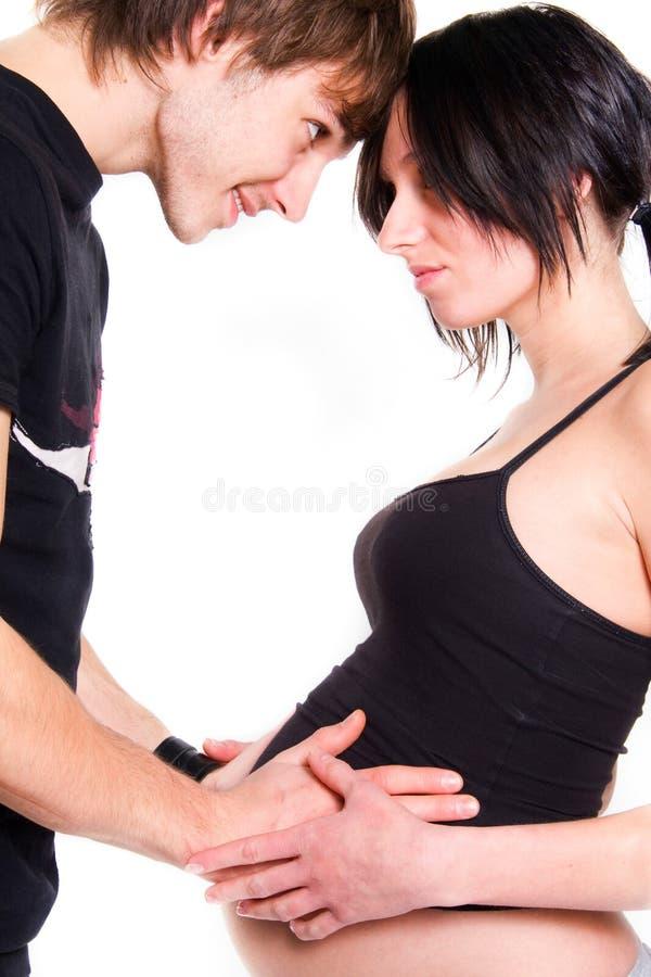 期待年轻人的婴孩夫妇 图库摄影