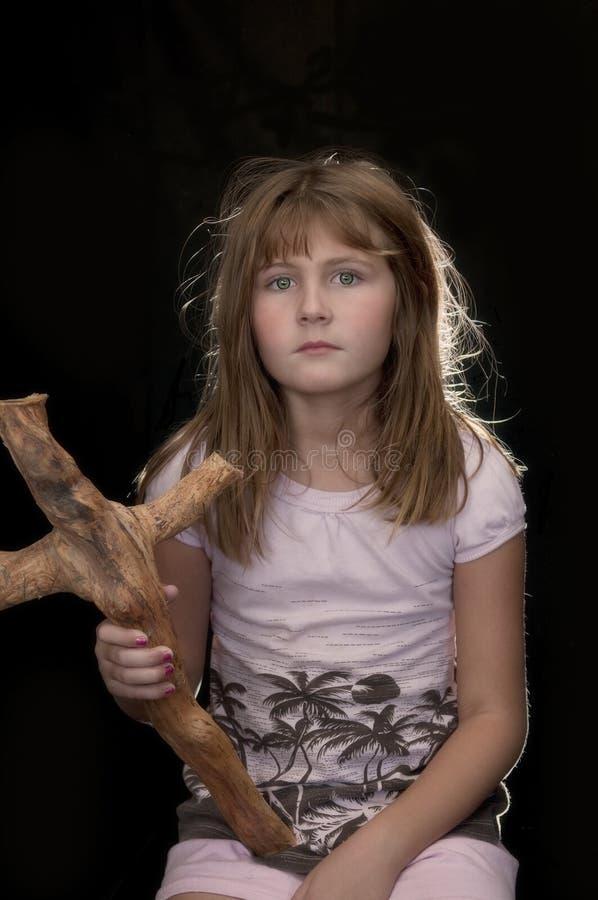木交叉的女孩 库存照片