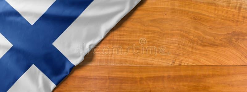 木制背景中带复制空间的芬兰国旗 免版税库存照片