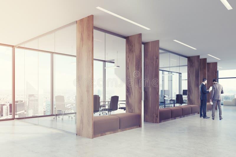 木办公室走廊角落,被定调子的棕色沙发 皇族释放例证