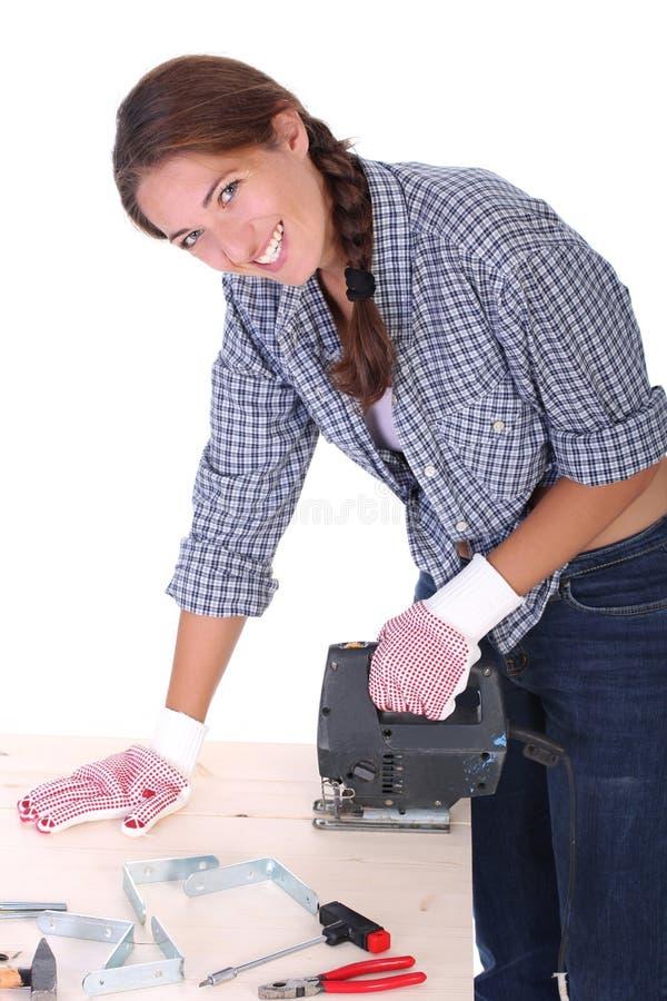 木匠妇女工作 免版税图库摄影