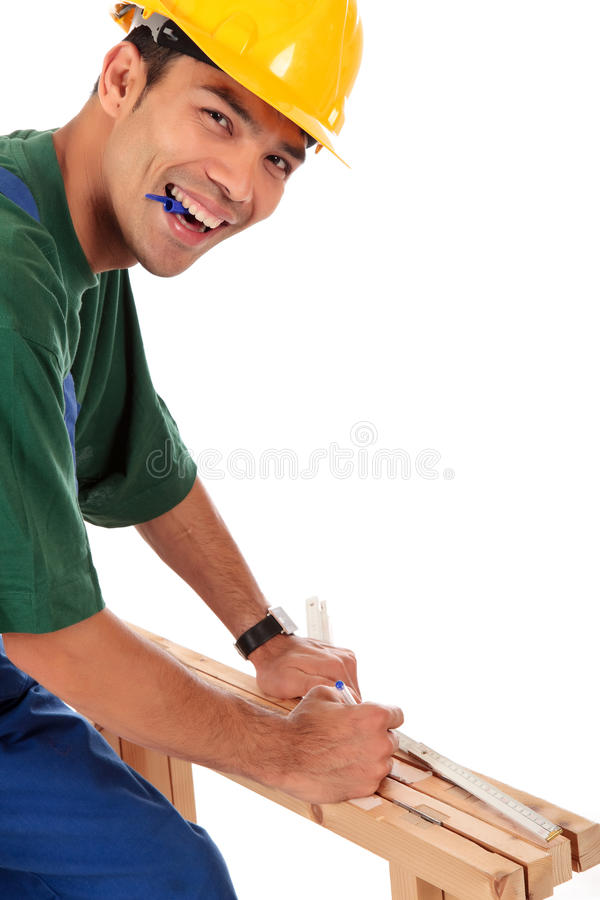 木匠尼泊尔微笑的年轻人 免版税库存照片