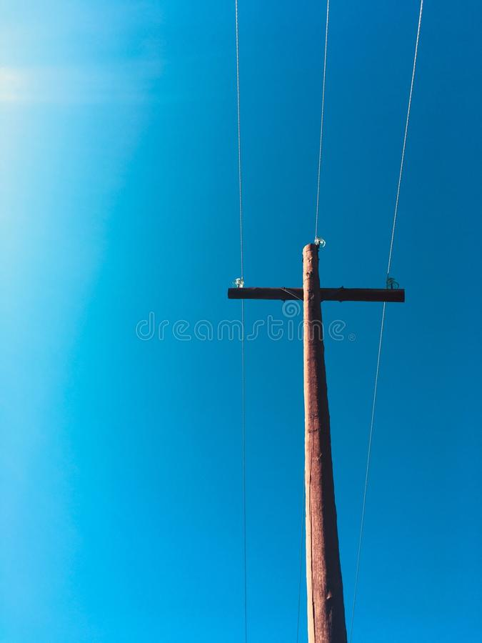 木十字架在阳光下 免版税库存照片
