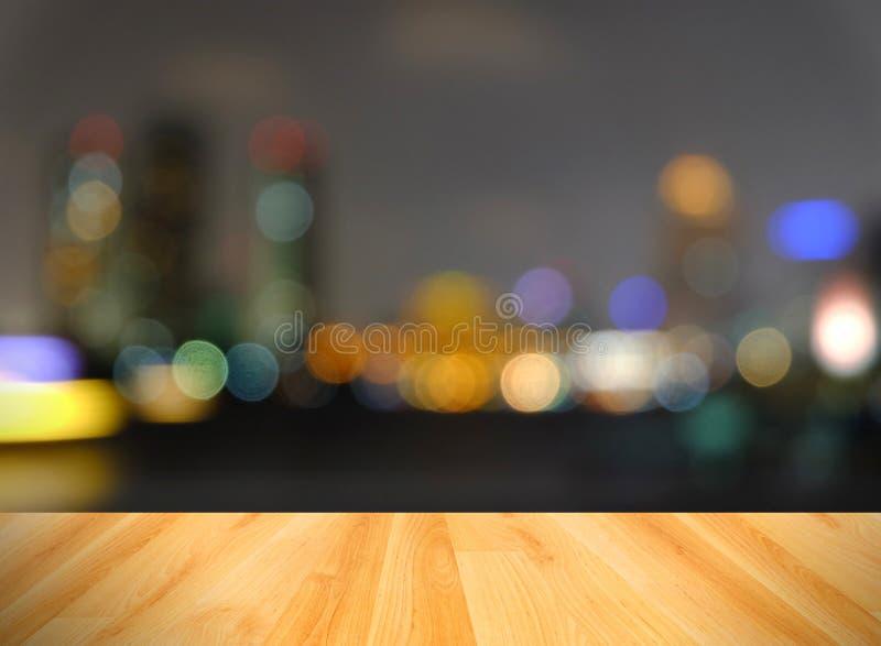 木地板和摘要弄脏了城市光,曼谷泰国 免版税库存图片