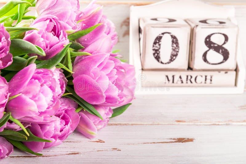 木块与国际妇女白天约会, 3月8日 免版税库存照片