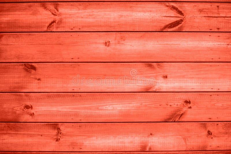 木户外板条珊瑚颜色墙壁背景 库存图片