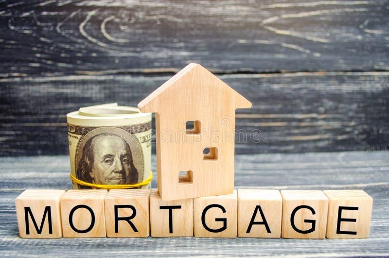 木房子和美元 木块和题字`抵押` 物产的信用 任何地方 真正的ES的工商业贷款 库存照片