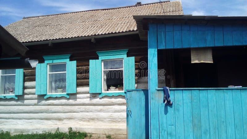 木房子在西伯利亚 免版税库存图片