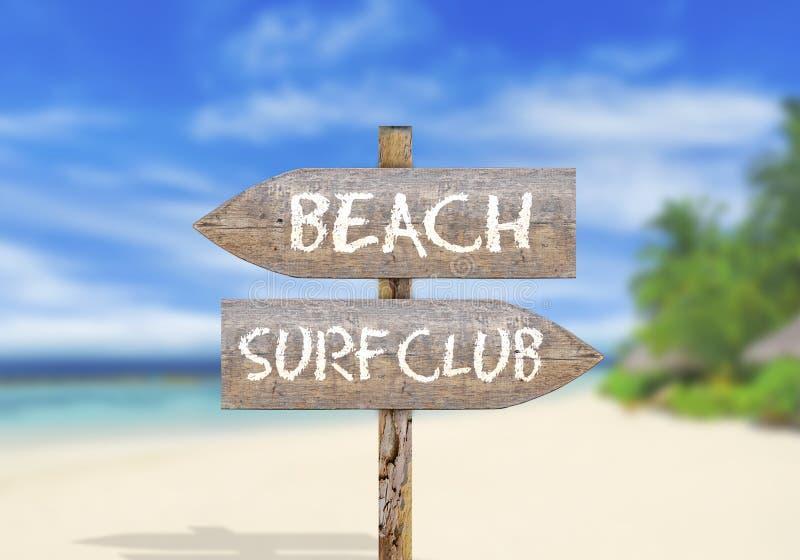 木方向标海滩或海浪俱乐部 免版税库存图片