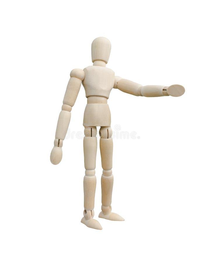 木木偶身分和指向他的手到左边 免版税库存照片