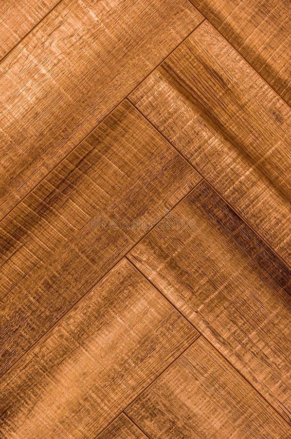 木条地板人字形V形臂章木头背景地板纹理 库存照片