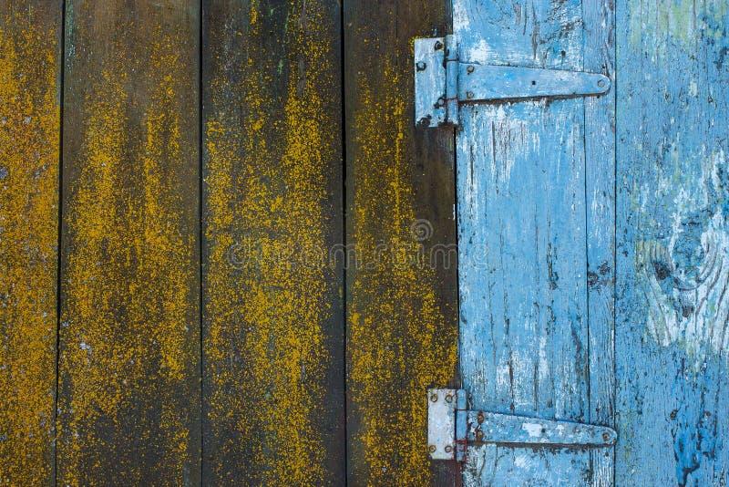 木板条和绘在蓝色颜色纹理 库存图片