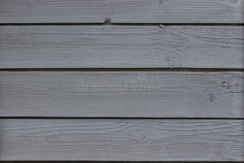 木板条构造,木房子墙壁灰色被绘的纹理背景 库存照片
