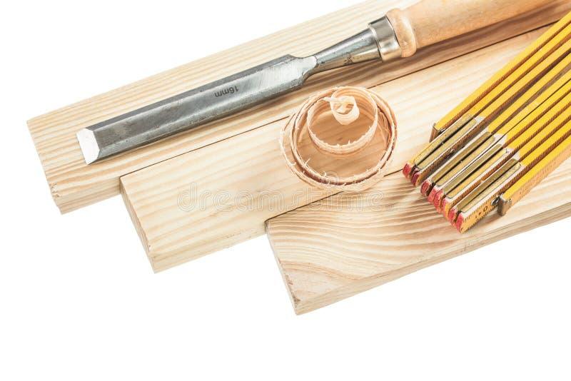 木板条测量在白色隔绝的平的凿子削片 库存图片
