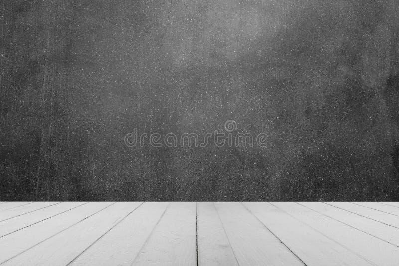木桌或木板条与混凝土墙或大理石墙壁背景的 免版税库存照片