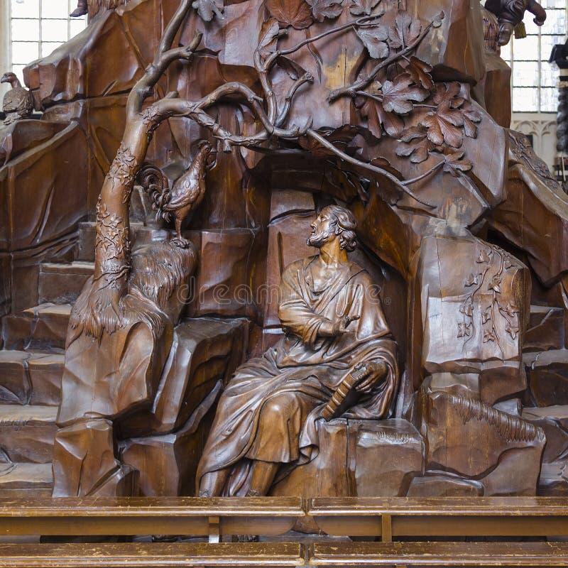 木椅子在圣皮特圣徒・彼得教会里在鲁汶 免版税图库摄影