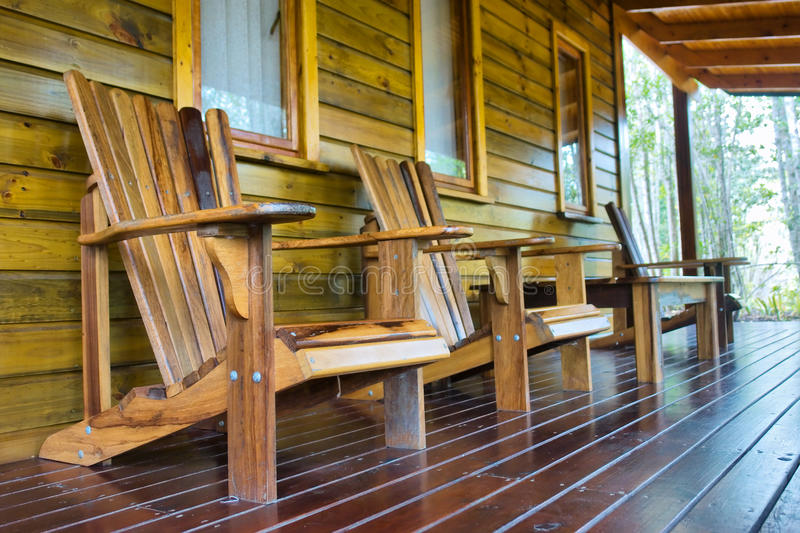 木椅子行在大阳台的 免版税图库摄影