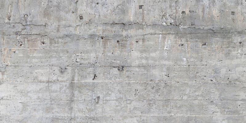 木模板纹理在一个未加工的混凝土墙盖印了 免版税库存照片