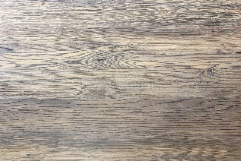 木纹理背景,点燃被风化的土气橡木 显示木纹纹理的退色的木被涂清漆的油漆 硬木 库存图片
