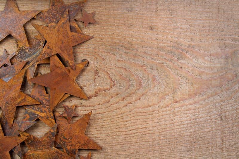 木背景生锈的星形 图库摄影