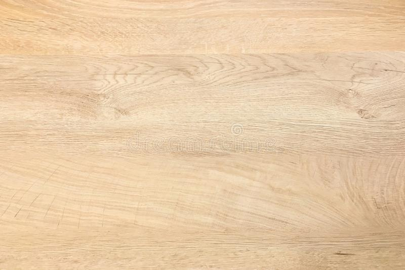 木背景纹理,点燃被风化的土气橡木 显示木纹纹理的退色的木被涂清漆的油漆 硬木被洗涤的板条 库存照片