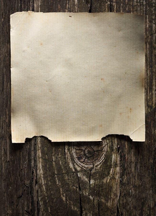 木背景老的纸张被弄脏 免版税库存照片