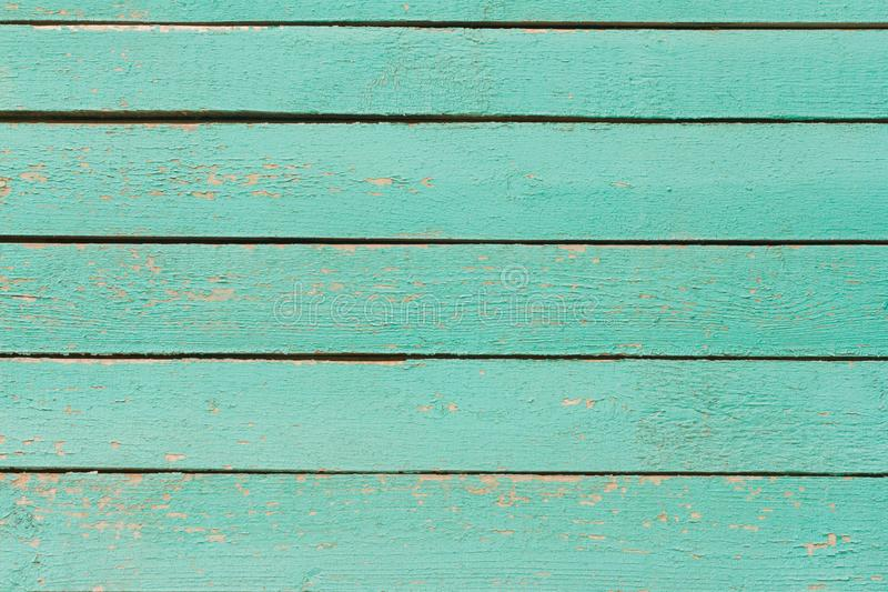 木背景,老木墙壁,被绘的蓝色,与裂缝和钉子 免版税库存图片