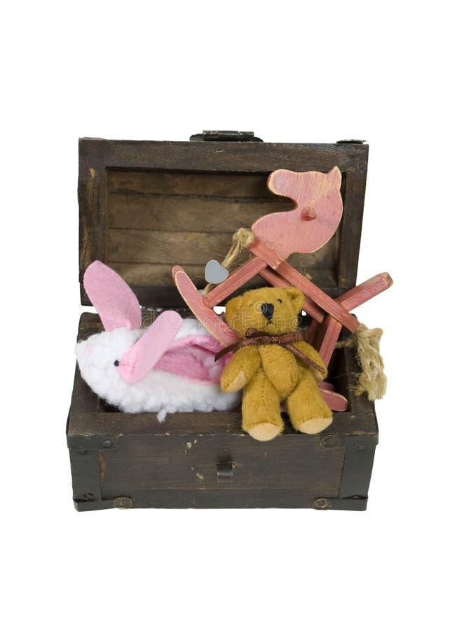 木胸口的玩具 库存图片