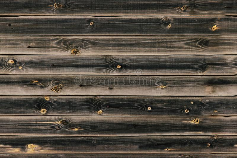 木衬里上墙壁 棕色黑暗的纹理木头 背景老盘区,无缝的样式 水平的板条 免版税图库摄影