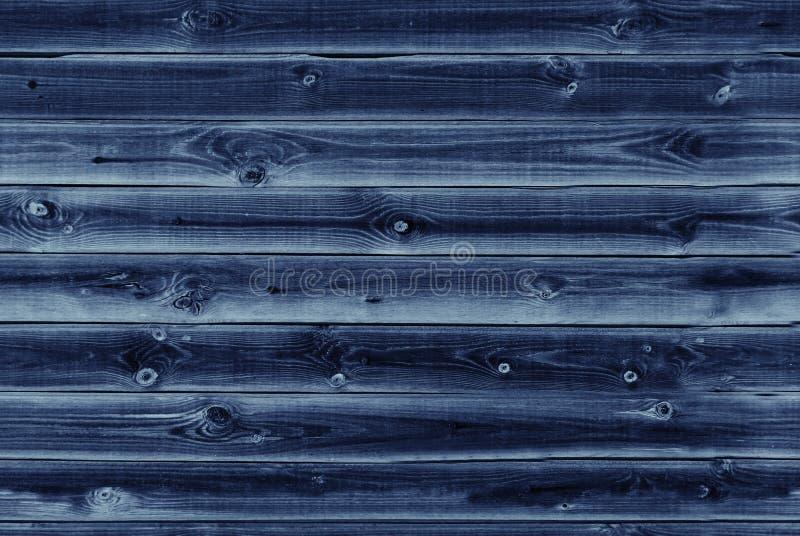 木衬里上墙壁 深蓝木纹理 背景老盘区,无缝的样式 水平的板条 库存照片