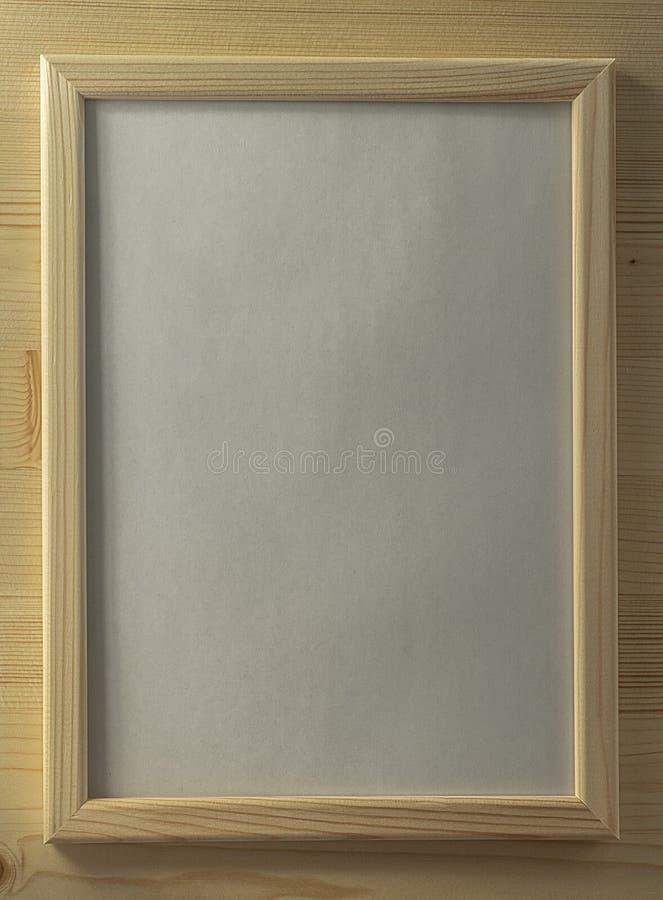 木质背景中的木框 免版税库存图片