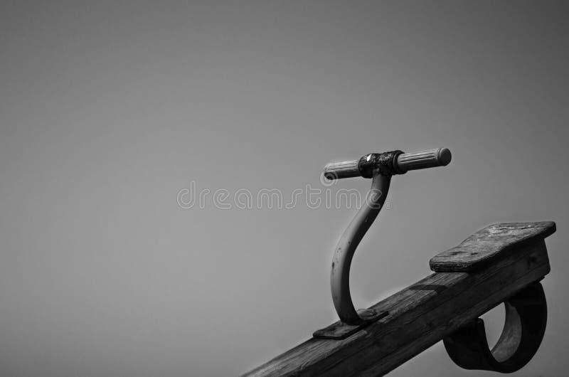 木跷跷板在室外操场 免版税库存照片