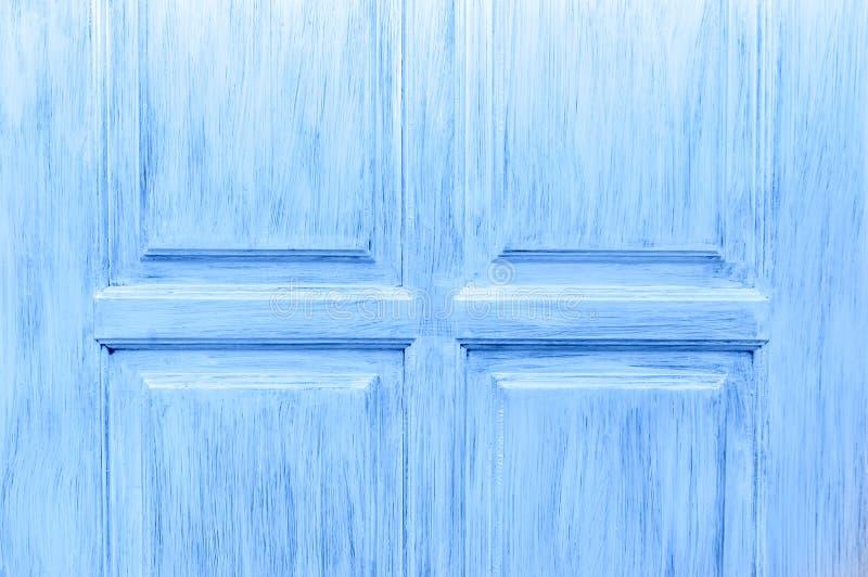 木门的片段是蓝色的 被绘的木头的纹理 免版税图库摄影