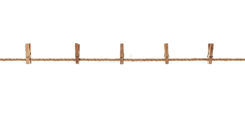 木头,垂悬在绳索的老服装扣子 免版税库存照片
