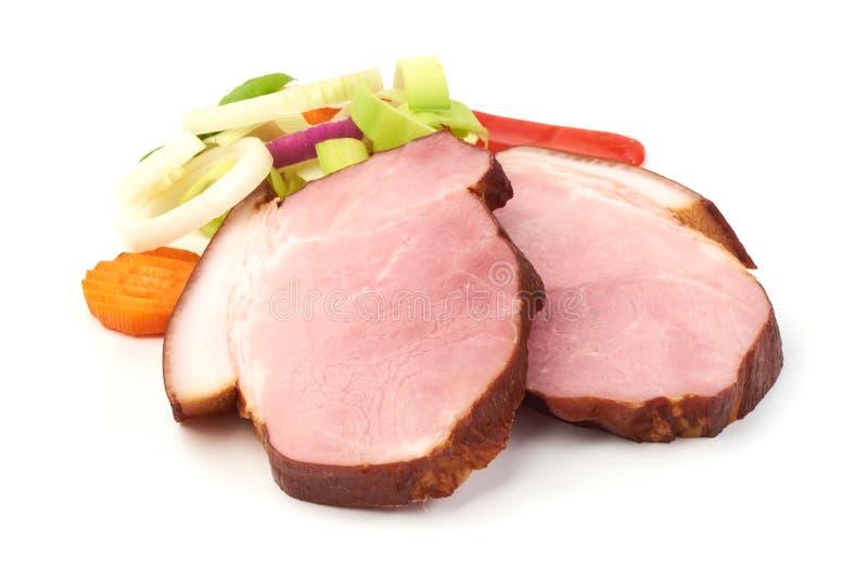 未加工的猪肉切了肉,特写镜头,隔绝在白色背景 库存照片