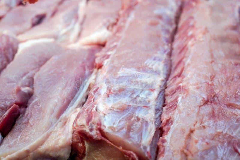 未加工的猪肉片断  免版税库存照片