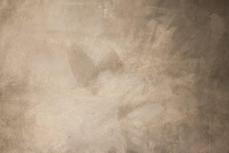 未加工的米黄具体背景 免版税库存图片