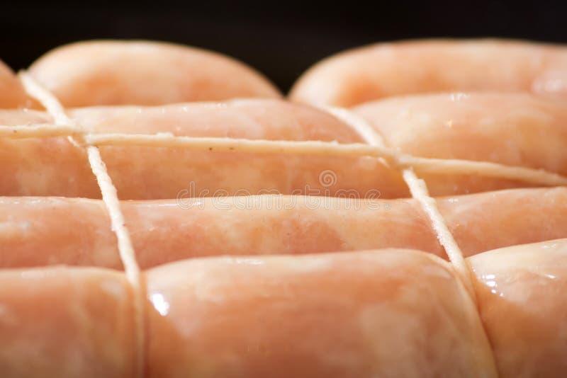 未加工的鸡香肠 免版税库存图片