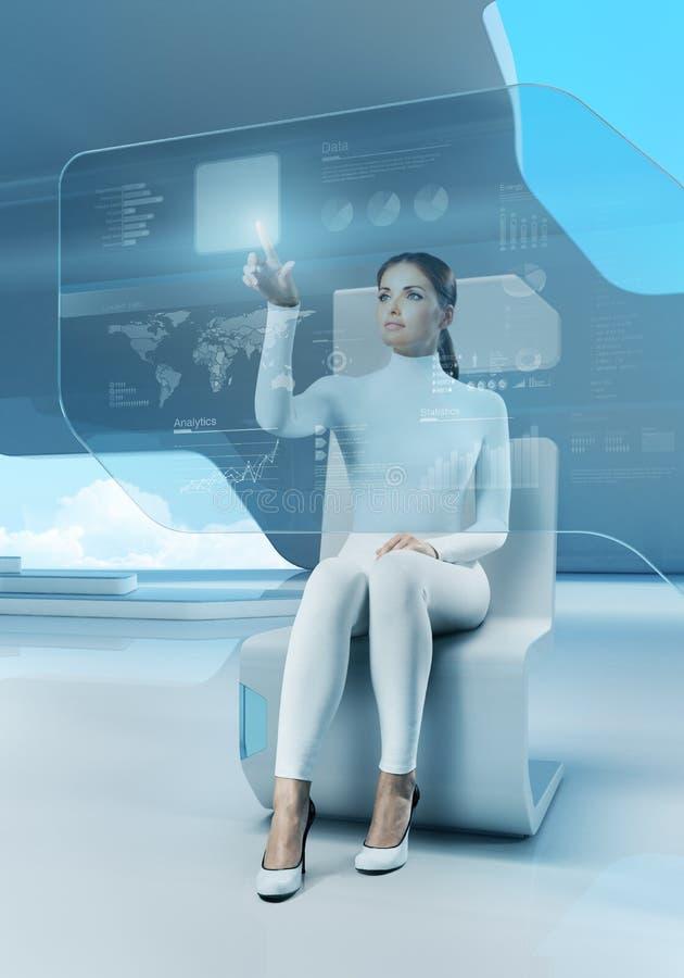 未来技术。 女孩按钮触摸屏幕接口。 免版税库存照片