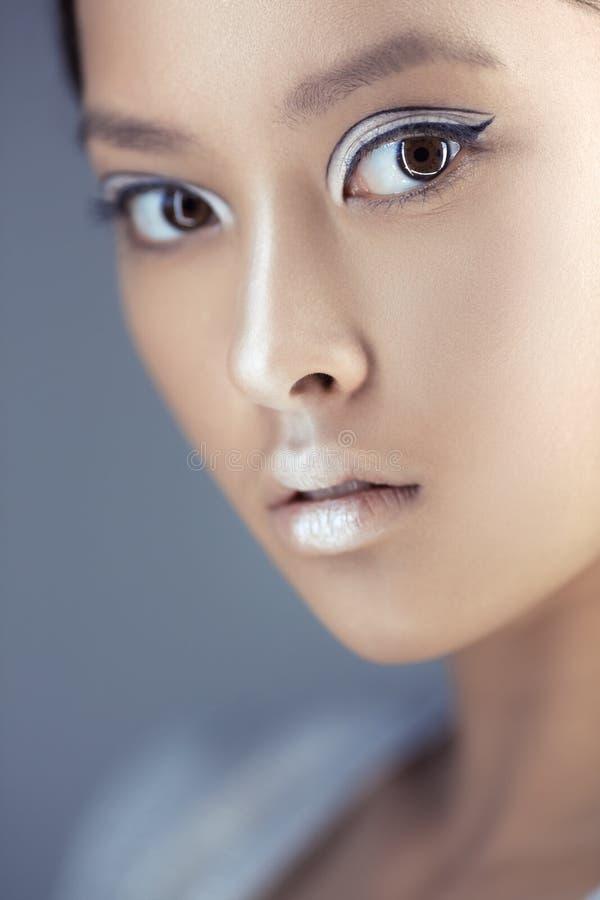 未来派年轻亚裔妇女 免版税库存图片