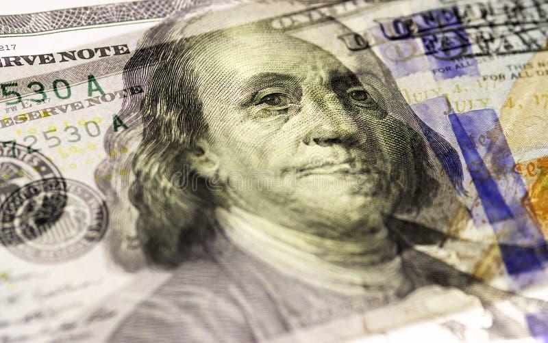 本杰明・富兰克林在美国一百或100面对美金宏指令,美国金钱特写镜头 免版税库存照片