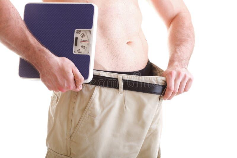 机体查出的男性肌肉缩放比例白色 免版税库存照片