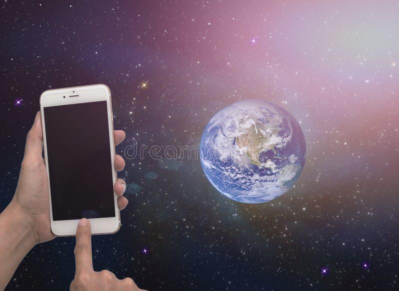 机动性在手中边世界 免版税库存照片
