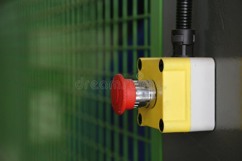 机器的红色开关在工厂 免版税库存图片