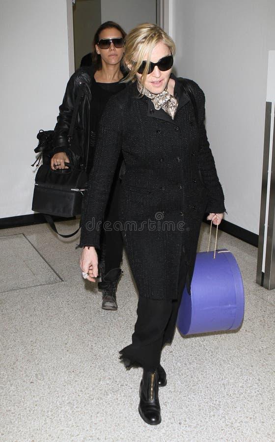 机场松驰madonna被看见的歌唱家 库存图片