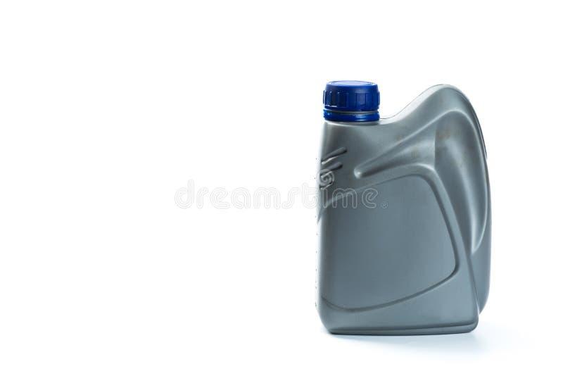 机油的塑胶容器在白色背景 库存照片