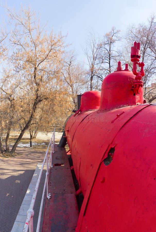 机车红色Communard在普希金公园 免版税库存照片