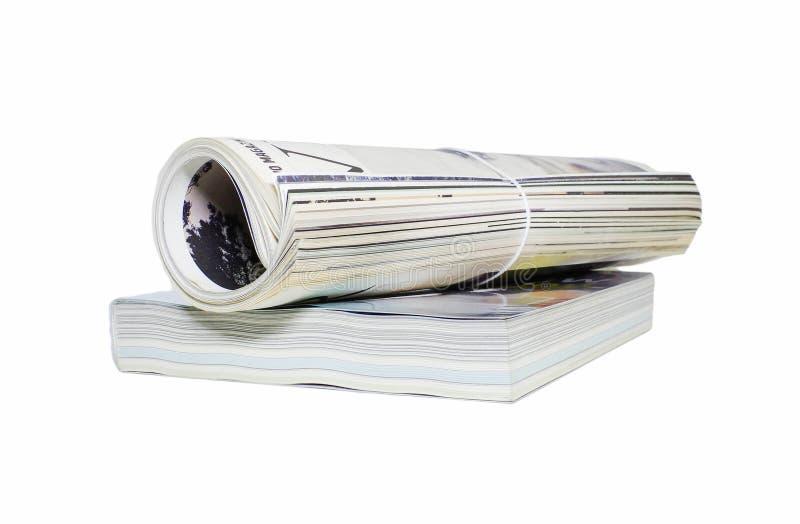 杂志卷和书在白色背景 库存照片