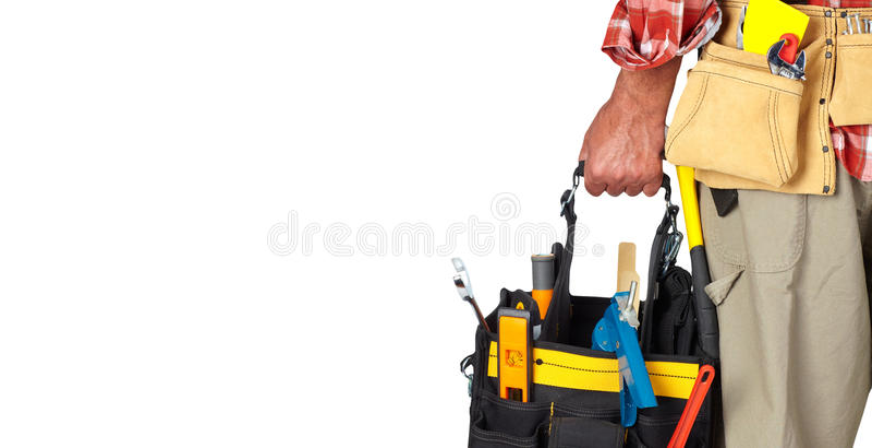杂物工的手有工具袋的 免版税图库摄影